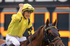 Tom Marquand punches the air after his brilliant ride to take a second Queen Elizabeth Stakes on Addeybb