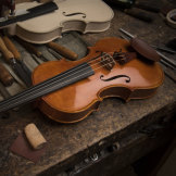 Harry Vatiliotis wants to slow down but will keep making violins from home.
