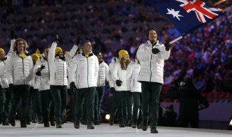 Alex Pullin carries the Australian flag into the stadium during the 2014 Winter Olympics in Sochi. Russian President Vladimir Putin ordered a plane reportedly en route to the ceremony to be shot down.