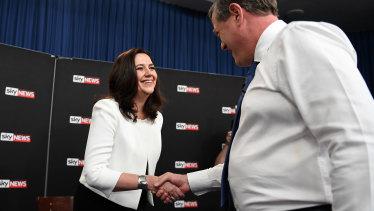 Queensland Premier Annastacia Palaszczuk shakes hands with Leader of the Opposition Tim Nicholls.