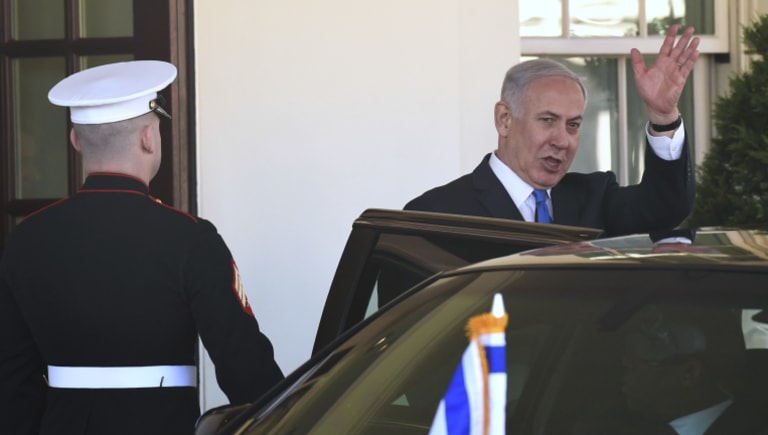Benjamin Netanyahu waves as he leaves the White House on Monday after meeting with Donald Trump.