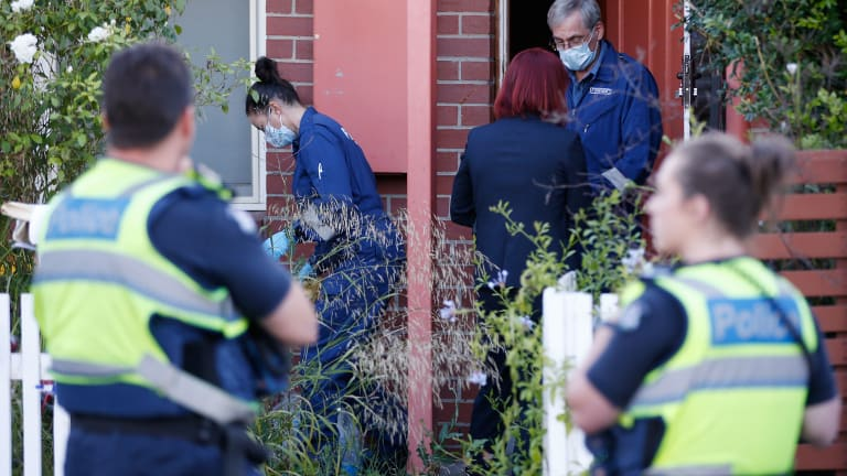 Police at a home in Kensington after the discovery of a body.