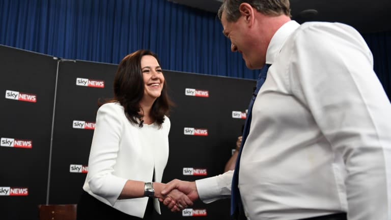 Queensland Premier Annastacia Palaszczuk shakes hands with Leader of the Opposition Tim Nicholls.