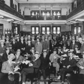 The gender of members at the Tattersall's Clubhas remained unchanged since its founding. Pictured is Settling day at the club for bookmakers and clients in 1926.