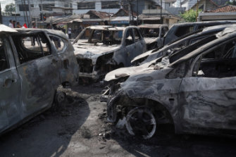 Cars burnt during protests.