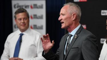 LNP leader Tim Nicholls looks on as One Nation state leader Steve Dickson addresses the People's Forum on Thursday night.