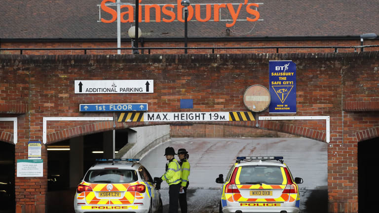 Police close the entrance to the car park of a supermarket after finding an abandoned car near to where former Russian double agent Sergei Skripal and his daughter were found critically ill.