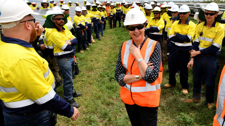 Annastacia Palaszczuk with workers at the Clare Solar Farm project in Ayr.
