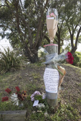 Flowers and notes of condolence are placed at Pavilion Reserve, Queenscliff, Sydney, where Liam Anderson was found dead.