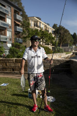 Jeremy Sims with a fish he caught at Balmain East.