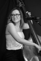 Lauren White performs the still-rare trick of singing while playing double bass.