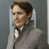 Fiona Shaw is stitched up in tweed as MI6's Carolyn Martens in series one.