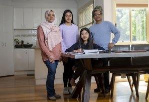 Suraiyah Akbar, husband Kamrul Ahsan and daughters Alisha and Saima.