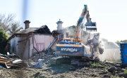 A bulldozer moves in on 368 Auburn Road, Hawthorn, on Friday.