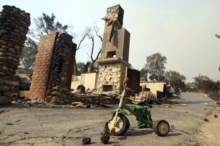 A child's toy stands outside one of at least 20 homes destroyed just on Windermere Drive in Malibu.
