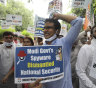 Congress party workers shout slogans during a protest accusing Prime Minister Narendra Modi's government of using military-grade spyware to monitor political opponents, journalists and activists in New Delhi, India.