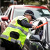 Police check cars for permits at a checkpoint in Coolangatta as the Queensland border on Friday.