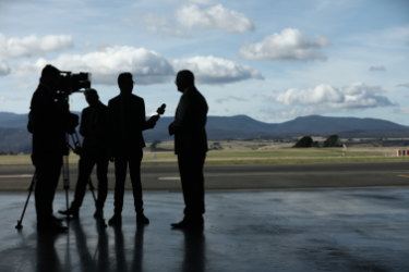 Prime Minister Scott Morrison being interviewed by local TV at an airport in Tasmania.