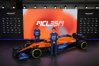 Daniel Ricciardo, left, and teammate Lando Norris, right, at the McLaren F1 car launch.