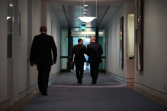 Prime Minister Scott Morrison and deputy leader Josh Frydenberg leaving a leadership spill on Friday.
