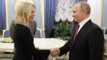 Russian President Vladimir Putin greets NBC News' Megyn Kelly before her interview with him in Moscow's Kremlin.