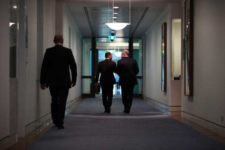 Prime Minister Scott Morrison and deputy leader Josh Frydenberg leaving a leadership spill on Friday.