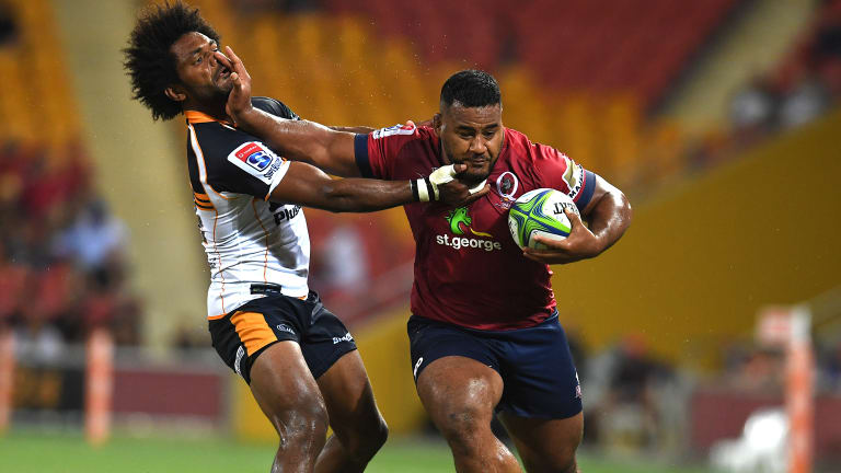 Taniela Tupou of the Reds (right) pushes Henry Speight of the Brumbies during the Round 3 Super Rugby match between the Queensland Reds and the Brumbies at Suncorp Stadium.