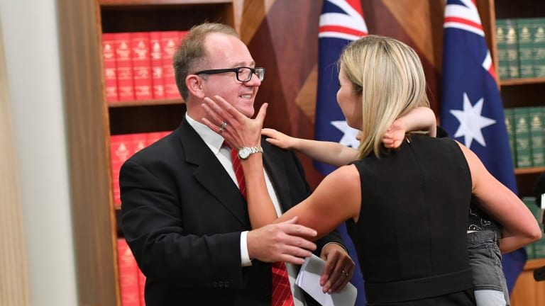 David Feeney, with his wife Liberty Sanger, announces his resignation from politics.