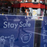 Coronavirus safety posters are displayed in the window of the Sondheim Theatre, London. The city is extended coronavirus restrictions over the Delta variant.