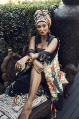"""Camilla """"Queen of Kings"""" kimono, $799. Eres Paroles bodysuit, $660, from Sylvia Rhodes Boutique. Kenneth Jay Lane tassel earrings, $220, from Pierre Winter Fine Jewels. Dinosaur Designs """"Orchid"""" bangle, $420."""