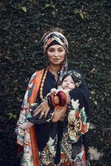 "Camilla ""Geisha Girl"" kimono coat, $599, ""Queen of Kings"" kimono blouse, $549, and ""Queen of Hearts"" headband, $79. Dinosaur Designs ""Boulder"" bangle, $105. Elsa Peretti for Tiffany & Co. bangles, $670 each. Other jewellery, her own."