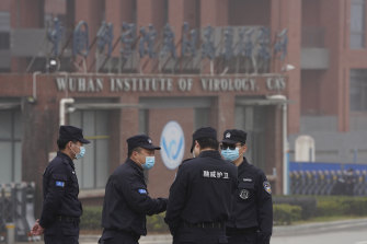 Security personnel gather near the entrance of the Wuhan Institute of Virology during a visit by the World Health Organisation team in February.