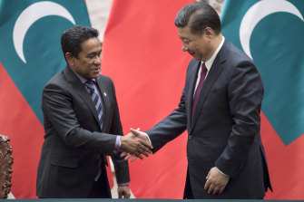 Maldives President Abdulla Yameen, left, shakes hands with China's President Xi Jinping in Beijing.
