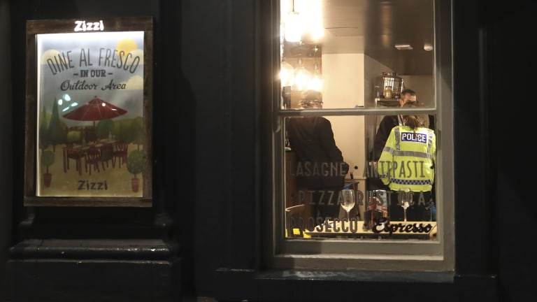 Police inside a restaurant in Salisbury that was closed in connection with the incident.