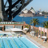 The harbourside pool is surrounded by the Sydney Harbour Bridge, Opera House and Luna Park.