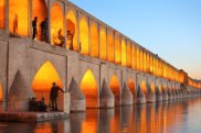 Khaju Bridge / Khajoo bridge over Zayandeh river at dusk with lights, Isfahan, Iran