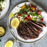 Seared scotch fillet with mozzarella, peas, tomatoes and herbs