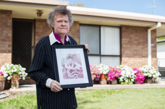 Bev Roberts at her Queensland home with a photo of her brother, Russell Martin.