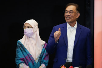 Malaysian opposition leader Anwar Ibrahim, right, and his wife, MP and former deputy PM Wan Azizah poses for a photo after meeting the King in Kuala Lumpur, Malaysia, on Tuesday.