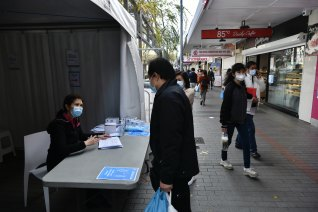A marquee outside Priceline at Cabramatta is offering information to the local community about AstraZeneca shots available inside.