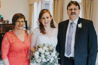 Hayley Smith with her parents, Murray and Jenny, on Hayley's wedding day.