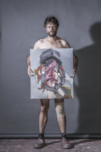 Quilty holds the painting Self Portrait after Injury No.4, 2018.