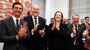 Liberal MPs Trevor Evans, Trent Zimmerman, Kelly O'Dwyer and Tim Wilson celebrate the result of the same-sex marriage postal survey at Parliament House in Canberra.