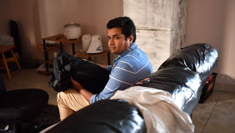 Mr Ponnamaneni was asleep on his couch when he was attacked by a trio of burglars.