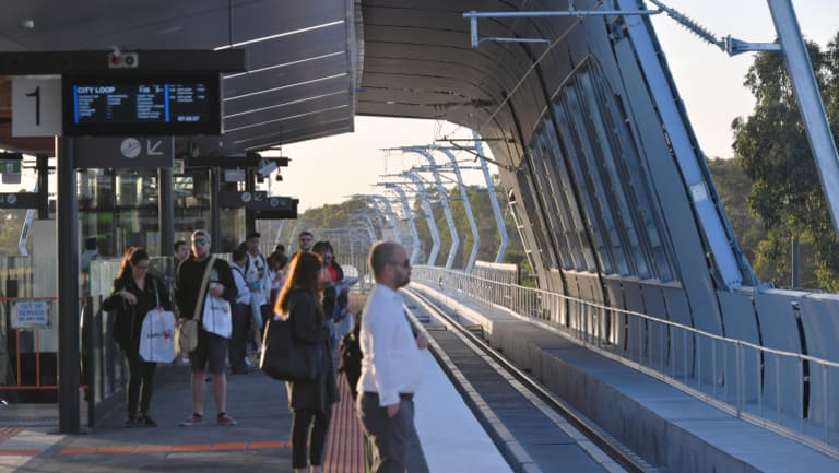 Passengers await one of the first sky rail trains on Thursday morning.