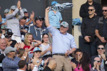Newly reelected Prime Minister Scott Morrison waves to the crowd during the Round 10 NRL match between the Cronulla Sharks and the Manly Sea Eagles at Pointsbet Stadium in Sydney, Sunday, May 19, 2019.