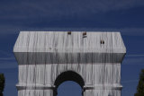 Workers finish wrapping the Arc de Triomphe in Paris