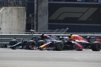 Mercedes driver Lewis Hamilton and Red Bull's Max Verstappen take a curve side by side.