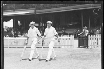Don Bradman and Stan McCabe going out to bat in 1930.