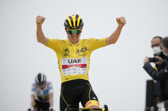 Tadej Pogacar, wearing the overall leader's yellow jersey, crosses the finish line on Wednesday.